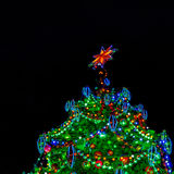 Artificial Cristmas tree top, lit up. Isolated Royalty Free Stock Photo