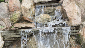 Artificial decorative waterfall with three modulations. Old artificial decorative waterfall with three modulations Stock Images