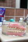 Artificial denture in a glass Stock Photo