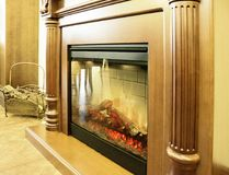 Fireplace as modern interior element. Artificial electric fireplace as decorative element in modern house interior Stock Image