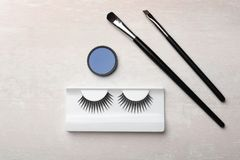 Artificial eyelashes and accessories on light background stock photos