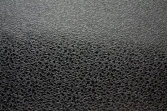 Artificial fabric granular texture glossy black Royalty Free Stock Photography