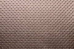 Artificial fabric texture Punto 19654 Bole brown color dotted Royalty Free Stock Image