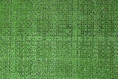 Artificial fake green grass carpet Stock Photos