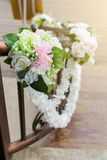 Artificial or Fake Rose Flower bouquet adorn. Artificial or Fake Rose Flower bouquet adorn on the Stair Handrail In Wedding Event royalty free stock photos