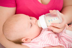 Artificial feeding of children. Royalty Free Stock Images