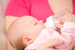 Artificial feeding of children. Royalty Free Stock Photo