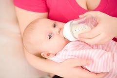 Artificial feeding of children. Stock Photo