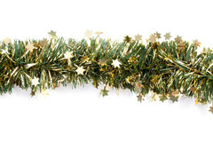 Artificial fir branch garland with tinsel Stock Images