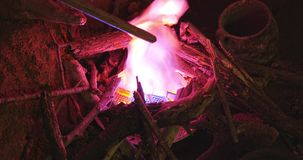 Artificial fire burning. In prehistoric cave above Roski waterfall in National park Krka stock footage