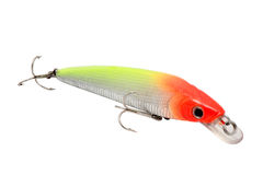 Artificial fish red and green. Imitation of fish lure for fishing for red and green colors with fishhooks triple cut and isolated Stock Photos