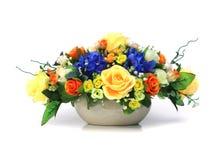 Artificial Flower Arrangement. Colorful Artificial Flower Arrangement on white background Stock Photo