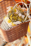 Artificial flower in bicycle basket Stock Image
