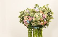 Artificial flower boquet. And green grass background royalty free stock photography