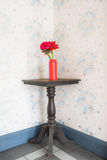 Artificial flower on corner table Royalty Free Stock Photography