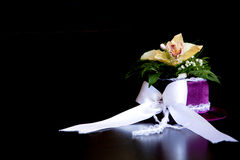 Artificial flower photographed indoors. Located on the table brown, with white bow Royalty Free Stock Images