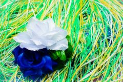 Artificial flower on a substrate of multi-colored thread Stock Image