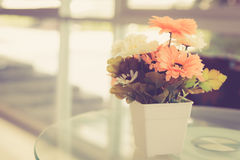 Artificial flower on table Stock Image