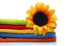 Artificial flower on towels Stock Photography