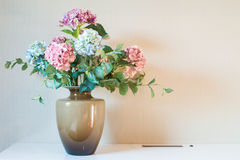 Artificial flower in vase. The Artificial flower in vase Stock Photo