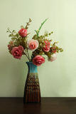 Artificial flower in vase  vintage style Royalty Free Stock Photos