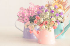 Artificial flower on vintage style background. Artificial flower on vintage filter style background Stock Image