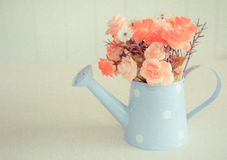 Artificial flower on vintage style background. Made with oil paint effect Stock Photography