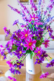 Artificial flower. In white vase Stock Images