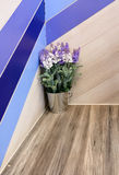 Artificial flower on wooden bar Stock Image