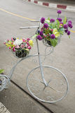 Artificial flowers on antique bicycle for decoration. Royalty Free Stock Images