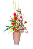Artificial flowers arrangement in vase isolated on white Stock Photos