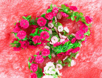 Artificial flowers as a heart. Stock Image