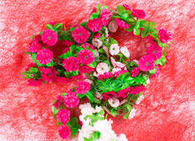 Artificial flowers as a heart. Royalty Free Stock Photos
