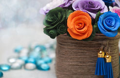 Artificial flowers in a basket Stock Photo