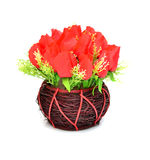 Artificial flowers in basket isolate on white Royalty Free Stock Image