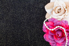 Artificial flowers on black background. With golden sequins Royalty Free Stock Image