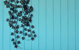 Artificial flowers on blue wooden wall Royalty Free Stock Images