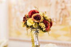 Artificial flowers bouquet in vase royalty free stock image