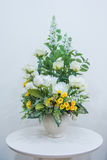 Artificial flowers bouquet in vase on the table. In home Royalty Free Stock Photos