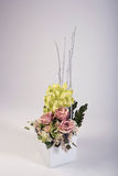 Artificial flowers bouquet in the vase  on white Royalty Free Stock Photo