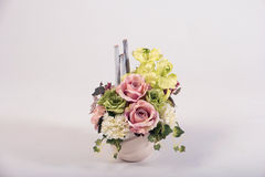 Artificial flowers bouquet in the vase  on white Stock Photography