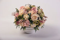 Artificial flowers bouquet in the vase  on white Royalty Free Stock Images