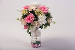 Artificial flowers bouquet in the vase  on white Stock Photo