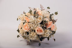 Artificial flowers bouquet in the vase  on white Royalty Free Stock Photos