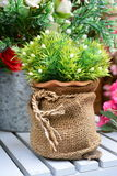 Artificial flowers in cloth sack. Royalty Free Stock Photos