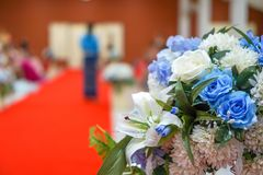 Artificial flowers decorated with red carpet royalty free stock photography