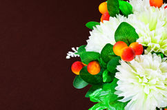Artificial flowers decorative against brown Royalty Free Stock Photography