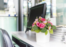 Artificial flowers. Artificial flower on the office desk : Depth of field Royalty Free Stock Image