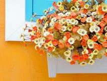 Artificial flowers in flowerpot Stock Image
