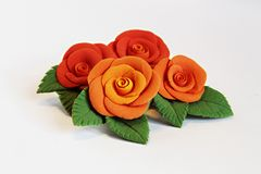 Artificial flowers (four big red roses) Stock Photo